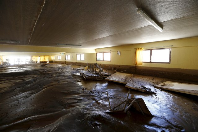 A view of a muddy saloon in a flooded warehouse in Los Loros town April 7, 2015. (Photo by Ivan Alvarado/Reuters)