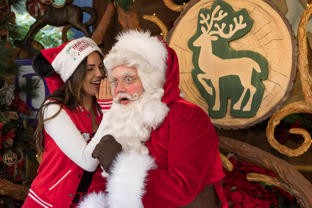 In this handout photo provided by Disneyland Resort, actress Eiza González meets the jolly old elf himself, Santa Claus, during the holidays at Disney California Adventure December 24, 2018 Park in Anaheim, California. The holidays continue at the Disneyland Resort with Disney Festival of Holidays, Believe  in Holiday Magic fireworks spectacular and more, through Jan. 6, 2019. (Photo by Joshua Sudock/Disneyland Resort via Getty Images)