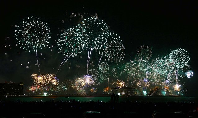 Fireworks explode in the sky over Dubai, United Arab Emirates. (Photo by Mohammed Omar /Reuters)