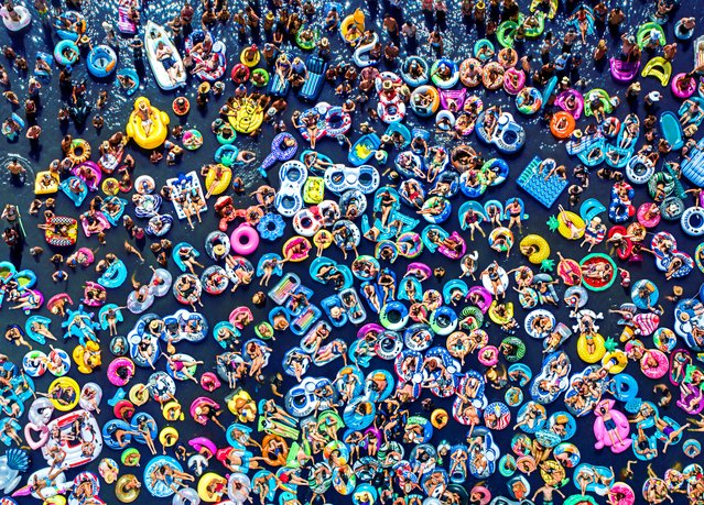 Floating People. People Commended. People in inner-tubes attend a concert on a floating stage. (Photo by Raf Willems/Drone Photography Awards 2021)