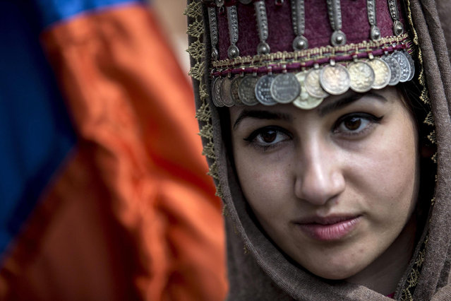 Armenians in Rome commemorate victims of the mass killings of Armenians under the Ottoman Empire during a rally in Rome, Italy, 24 April 2015. On 24 April 1915 the Ottoman Empire started the extermination of its minority Armenian population. A total number of between one and 1.5 million people are believed were killed during the massacre. (Photo by Massimo Percossi/EPA)
