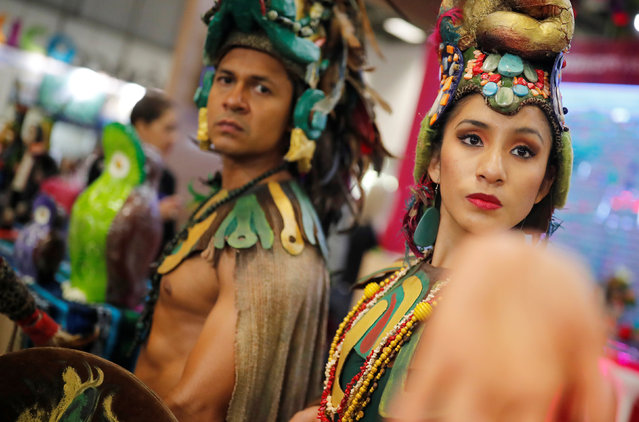 Exhibitors representing Guatemala pose at the International Tourism Trade Fair ITB in Berlin, Germany, March 6, 2019. (Photo by Hannibal Hanschke/Reuters)