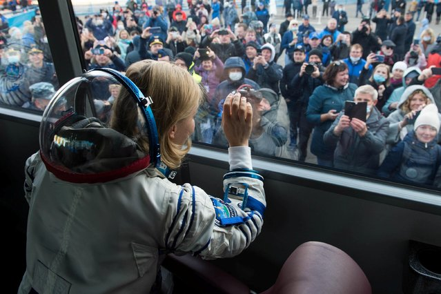 """This handout photo taken and released on October 5, 2021 by Russian Space Agency Roscosmos shows Russian crew member, actress Yulia Peresild reacting inside a bus prior to the launch onboard the Soyuz MS-19 spacecraft at the Russian-leased Baikonur cosmodrome. A Russian actress and director arrived at the International Space Station (ISS) on October 5, 2021 to begin a 12-day mission to make the first movie in orbit. The Russian crew is set to beat a Hollywood project that was announced last year by """"Mission Impossible"""" star Tom Cruise together with NASA and Elon Musk's SpaceX. (Photo by Andrey Shelepin/Russian Space Agency Roscosmos/AFP Photo)"""