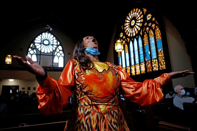 Wanda Young sings during the reopening for in-person church services after nearly 18 months of virtual services because of the coronavirus disease (COVID-19) pandemic at Grant AME Church in Boston, Massachusetts, U.S., October 3, 2021. (Photo by Brian Snyder/Reuters)