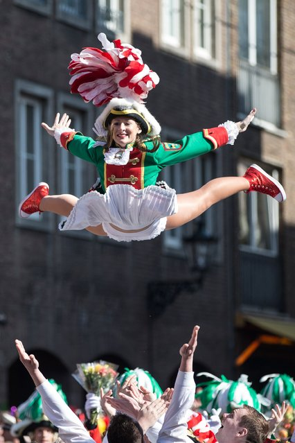 """""""Funkenmariechen"""" perform during a street parade on March 13, 2016 in Duesseldorf, western Germany. The street parade was postponed due to a storm warning. (Photo by Maja Hitij/AFP Photo/DPA)"""