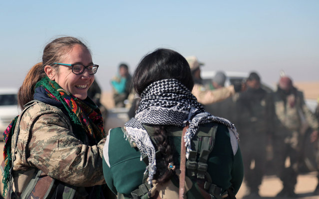 A volunteer British fighter talks with Syrian Democratic Forces (SDF) in the north of Raqqa city, Syria February 3, 2017. Picture taken February 3, 2017. (Photo by Rodi Said/Reuters)