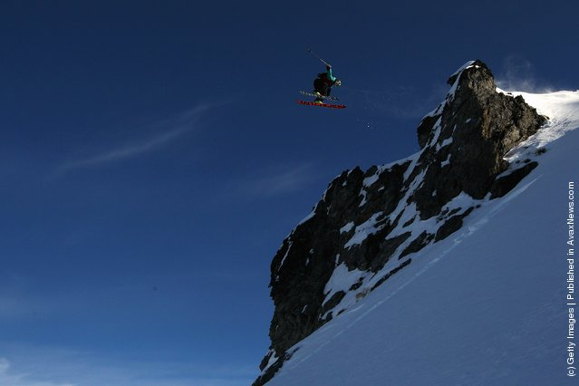 Freeskier Chris Booth of Australia launches off a drop during the World Heli Challenge freestyle day in backcountry at Minaret Station on July 31, 2011 in Wanaka, New Zealand