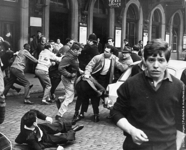 A fight breaks out between anti-Fascists and supporters of Oswald Mosley's Union Movement in the forecourt of Charing Cross Station in London, 12th May 1963