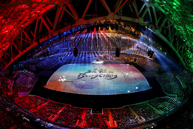 """A general view as """"See You In PyeongChang"""" is projected during the 2014 Sochi Winter Olympics Closing Ceremony at Fisht Olympic Stadium on February 23, 2014 in Sochi, Russia. (Photo by Matthew Stockman/Getty Images)"""