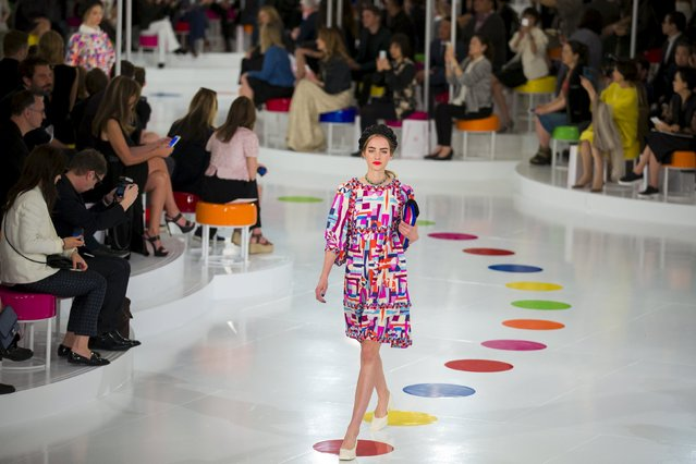 A model presents a creation of the Chanel Cruise Collection 2015/16 at the Dongdaemun Design Plaza in Seoul, May 4, 2015. (Photo by Thomas Peter/Reuters)