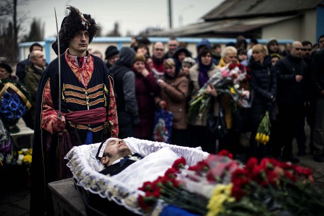 Protesters opposing Russia's move to seize the Crimean Peninsula attend a funeral for Vlad Zubenko, who was killed in recent clashes with police in Kiev, in the eastern Ukrainian city of Kharkiv, on March 2, 2014. (Photo by Uriel Sinai/The New York Times)