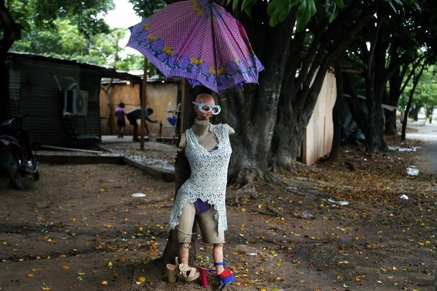 "A mannequin nicknamed ""Miss Evacuated"", placed by evacuee Rosa Nuñez, stands outside a shelter for flood victims in Asuncion, Paraguay, Tuesday, May 7, 2019. Officials say they've had to evacuate some 40,000 people due to unusually heavy rains since March. (Photo by Jorge Saenz/AP Photo)"