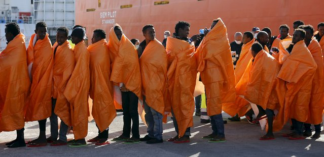 Migrants stands in line after disembarking from the Norwegian vessel Siem Pilot at Pozzallo's harbour, Italy, March 29, 2016. (Photo by Antonio Parrinello/Reuters)