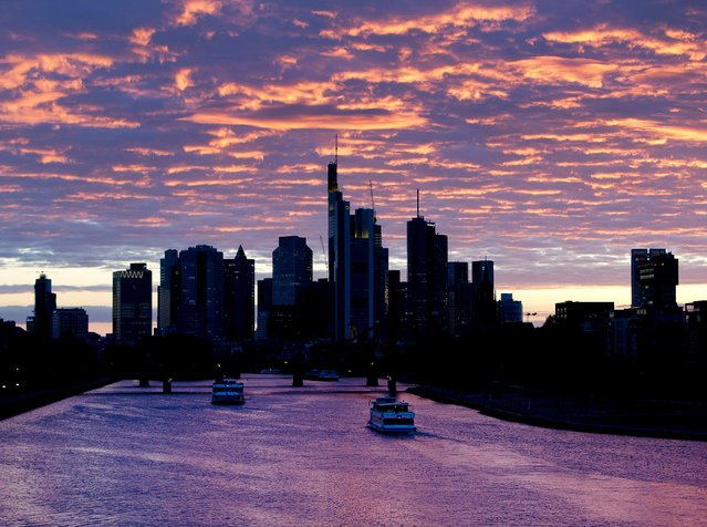 Ships pass by on the river Main after the sun set in Frankfurt, Germany, Wednesday, May 15, 2019. (Photo by Michael Probst/AP Photo)