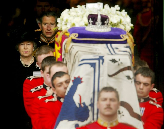 Britain's Queen Elizabeth walks behind her mother's coffin following the Queen Mother's funeral at Westminster Abbey in London, in this April 9, 2002 file photo. (Photo by Dan Chung/Reuters)