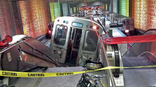 "A Chicago Transit Authority train car rests on an escalator at the O'Hare Airport station after it derailed early Monday, March 24, 2014, in Chicago. More than 30 people were injured after the train ""climbed over the last stop, jumped up on the sidewalk and then went up the stairs and escalator"", according to Chicago Fire Commissioner Jose Santiago. (Photo by Kenneth Webster/AP Photo/NBC Chicago)"
