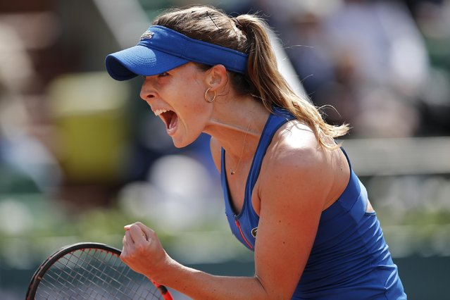 France's Alize Cornet celebrates scoring a point in the first round match of the French Open tennis tournament against Italy's Roberta Vinci at the Roland Garros stadium, in Paris, France, Monday, May 25, 2015. (Photo by Christophe Ena/AP Photo)
