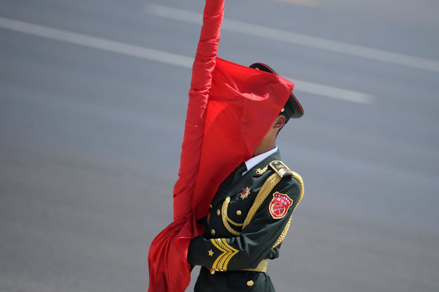 A member of the Chinese honour guard attends a welcome ceremony for Bangladeshi Prime Minister Sheikh Hasina outside the Great Hall of the People in Beijing, China, July 4, 2019. (Photo by Jason Lee/Reuters)
