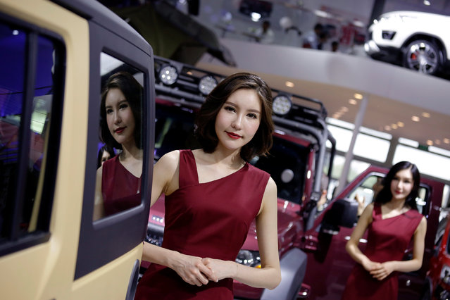 Hostesses stand between vehicles presented at Beijing Automotive Group (BAIC) booth during Auto China 2016 auto show in Beijing April 25, 2016. (Photo by Damir Sagolj/Reuters)