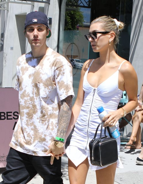Justin Bieber and Hailey Baldwin get lunch after getting piercings together Sunday, July 21, 2019 in West Hollywood, CA.!  Hailey wore a s*xy white dress with a faux shirttail peeking out from the bottom and ruching on the butt!  Justin took a break from Drew House merch and sported a tie dye t-shirt and black pants. They ate healthy at Backyard Bowls in West Hollywood. (Photo by Juliano/X17online.com)