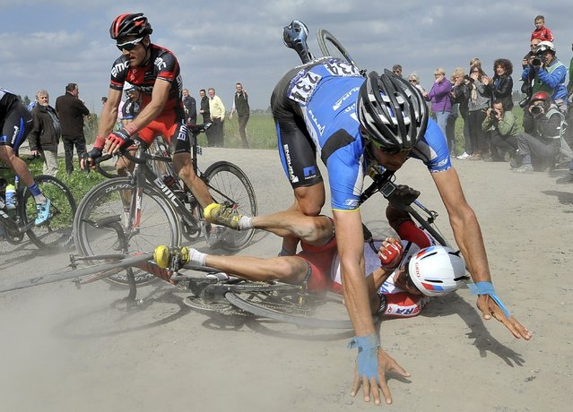 Netapp Endura team rider Slovenian Blaz Jarc (R) crashes into Katusha team rider Russian Viacheslav Kuznetsov (ground) during the 112th Paris Roubaix cycling race, in Roubaix, France, 13 April 2014. (Photo by Nicolas Bouvy/EPA)