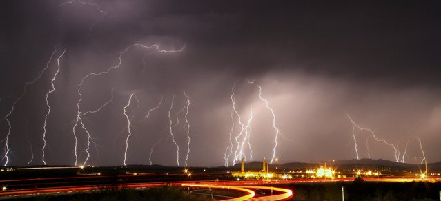 Mass lightning bolts light up night skies by Daggett airport from monsoon storms passing over the high deserts early Wednesday, north of Barstow, California, July 1, 2015. Picture taken using long exposure. (Photo by Gene Blevins/Reuters)