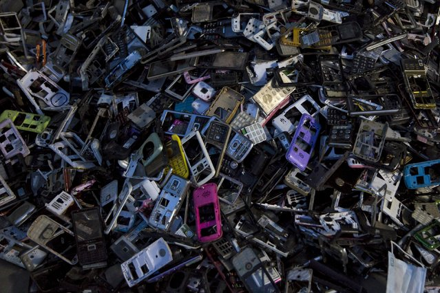 Old cellular phone components are discarded inside a workshop in the township of Guiyu in China's southern Guangdong province June 10, 2015. (Photo by Tyrone Siu/Reuters)