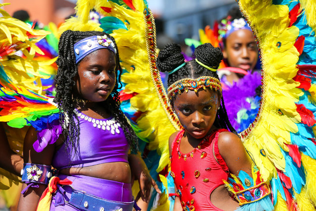 Kid dancers in costumes during the children parade on the family day of Notting Hill Carnival in west London on August 25, 2019. Thousands of revellers take part in Notting Hill Carnival, Europe's largest street party and a celebration of Caribbean traditions and the capital's cultural diversity. (Photo by Dinendra Haria/SOPA Images/Sipa USA)