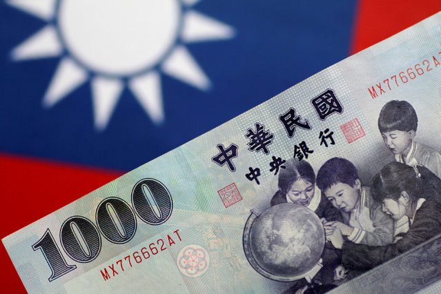 A Taiwan dollar note is seen in this illustration photo May 31, 2017. (Photo by Thomas White/Reuters)