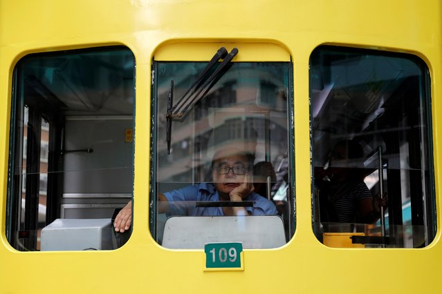 A man sits inside a light rail at Wan Chai neighborhood in Hong Kong, China, August 23, 2019. (Photo by Willy Kurniawan/Reuters)