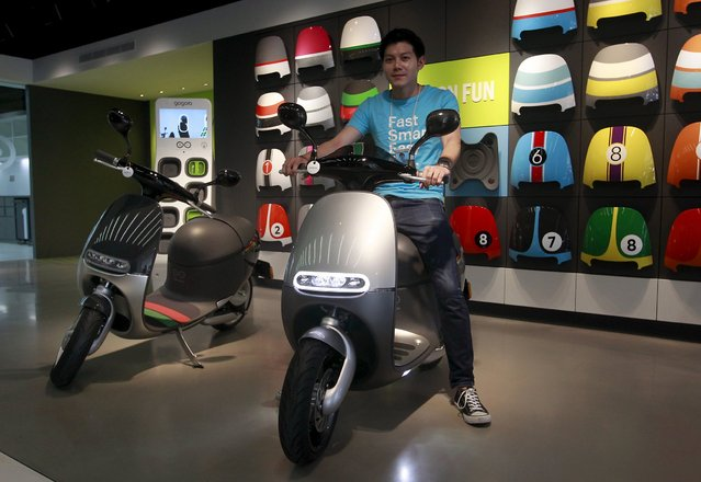 Gogoro Smartscooters are displayed in its shop in Taipei, Taiwan, July 6, 2015. Companies such as electric motor scooter firm Gogoro could hold the key to Taiwan's economic growth. In just three years, the start-up raised $150 million to develop the smartphone-synched bike, and a charging network for it. (Photo by Pichi Chuang/Reuters)
