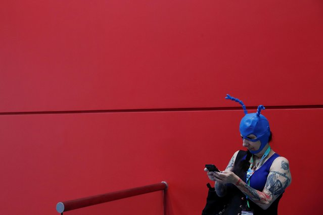 A person dressed in costume uses her cellphone at the 2019 New York Comic Con in New York City, New York, U.S., October 3, 2019. (Photo by Shannon Stapleton/Reuters)