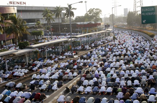 Muslims take part in an Eid al-Fitr prayer on the street in Jakarta, Indonesia July 17, 2015. Indonesia, which has the world's largest Muslim population, celebrates Eid al-Fitr with mass prayers and family visits to mark the end of the holy fasting month of Ramadan. (Photo by Nyimas Laula/Reuters)