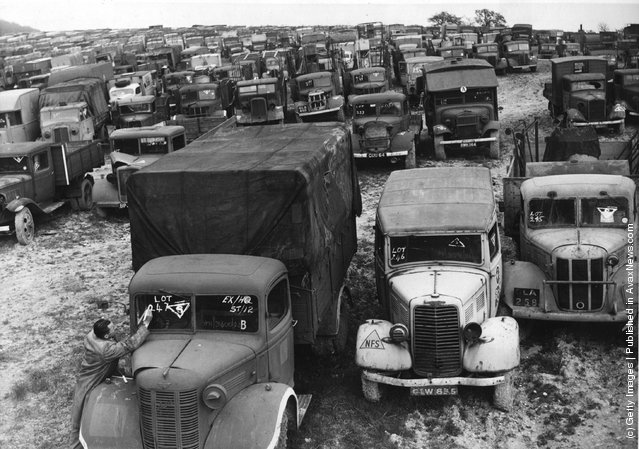 1946: A man marks lot numbers on lorries for the car auction sale at Great Missenden, Bucks, at which thousands of cars and lorries will be offered for sale in the biggest car auction sale ever held in Britain