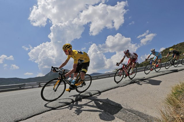 Britain's Chris Froome, wearing the overall leader's yellow jersey, is followed by Spain's Alberto Losada, Italy's Vincenzo Nibali and Spain's Alejandro Valverde as they speed downhill during the seventeenth stage of the Tour de France cycling race over 161 kilometers (100 miles) with start in Digne-les-Bains and finish in Pra Loup, France, Wednesday, July 22, 2015. (Photo by Christophe Ena/AP Photo)