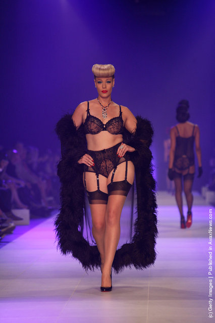 Models showcases designs by Von Folies by Dita Von Teese on the runway during L'Oreal Melbourne Fashion Festival
