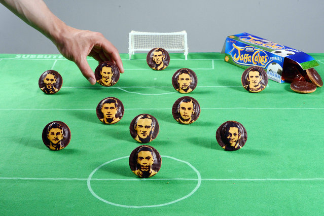 A food artist has given the England football team a taste of success – by recreating their faces on Jaffa Cakes.  Annabel de Vetten, 42, has created intricate designs showing Roy Hodgson's men that the beautiful game really can be a piece of cake. (Photo by Solent News/Splash News)