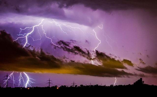 Lightning strikes in Algermissen, Germany in the early morning hours, on June 10, 2014. Authorities say at least six people were killed in western Germany as heavy rains, hail and high winds battered the region. (Photo by Julian Stratenschulte/DPA)