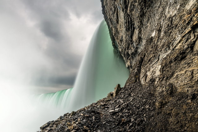 """""""Liquid Emerald"""". I stood at the base of Niagara Falls in Ontario Canada with my camera, tripod and ND filter and 10 million gallons of water per minute. My camera was soaking when I was done and didn't think I had achieved the effect I wanted, but later found out it was worth taking an involuntary shower compliments of mother nature to get this photo. Photo location: Niagara Falls, Ontario, Canada. (Photo and caption by Barry Hodgert/National Geographic Photo Contest)"""