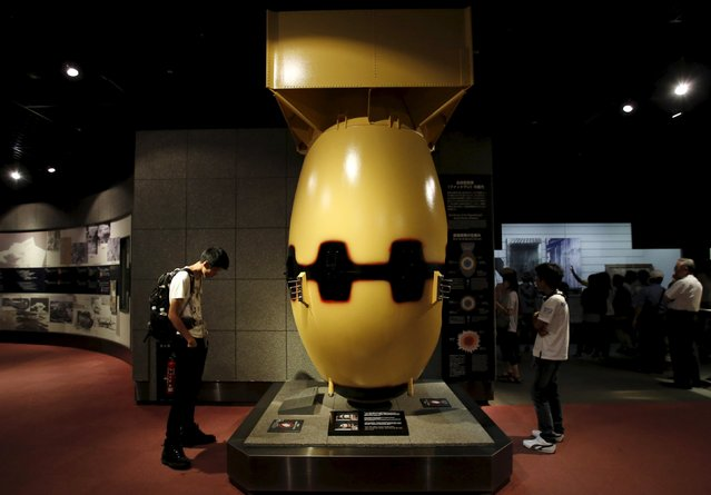 "Visitors look at a mock Nagasaki-type atomic bomb named ""Fat Man"" at the Nagasaki Atomic Bomb Museum in Nagasaki, western Japan, August 8, 2015, on the eve of the 70th anniversary of the bombing of Nagasaki. Japan will mark on Sunday the 70th anniversary of the attack on Nagasaki, where the U.S. dropped a second atomic bomb on August 9, 1945, which killed about 40,000 instantly. (Photo by Toru Hanai/Reuters)"