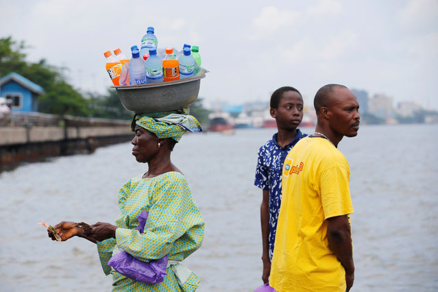 A woman sells drinks at a jetty in Marina in Nigeria's commercial capital Lagos June 17, 2016. (Photo by Akintunde Akinleye/Reuters)