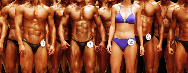 "A female competitor (4th R) of the ""Post-secondary College Body Fitness"" category stands on the stage with other male competitors during the Hong Kong Bodybuilding Championship in Hong Kong June 11, 2006. (Photo by Paul Yeung/Reuters)"
