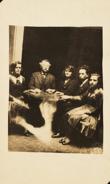 A seance. A photograph of a group gathered at a seance, taken by William Hope (1863-1933) in about 1920