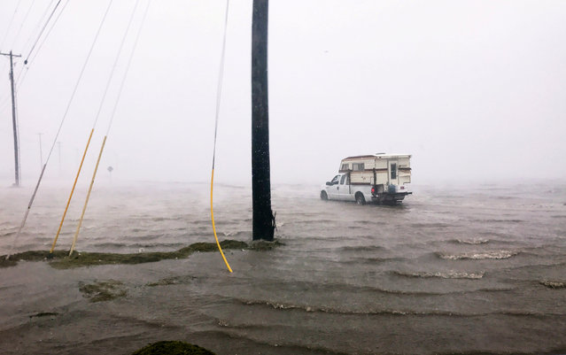 "Craig ""Cajun"" Uggen, 57, nearly floods his truck as Hurricane Harvey comes ashore in Corpus Christi, Texas, U.S. August 25, 2017. Minutes later, high winds blew off the camper carrying all of his belongings. (Photo by Brian Thevenot/Reuters)"