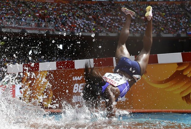 Rolanda Bell of Panama falling head first into the water obstacle during the women's 3000 metres steeplechase heats at the 15th IAAF World Championships in the National Stadium in Beijing, China August 24, 2015. (Photo by Kai Pfaffenbach/Reuters)