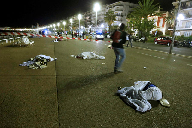 Bodies are seen on the ground July 15, 2016 after at least 30 people were killed in Nice, France, when a truck ran into a crowd celebrating the Bastille Day national holiday July 14. (Photo by Eric Gaillard/Reuters)