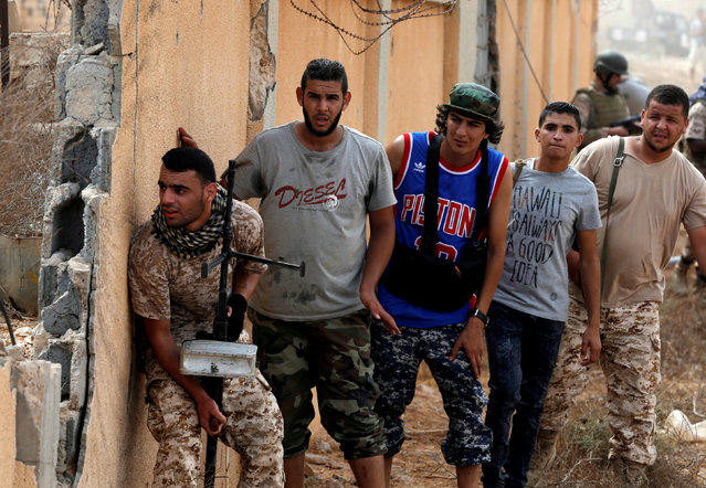 Libyan forces allied with the U.N.-backed government look at Islamic State fighters' positions in Sirte, Libya, July 15, 2016. (Photo by Goran Tomasevic/Reuters)
