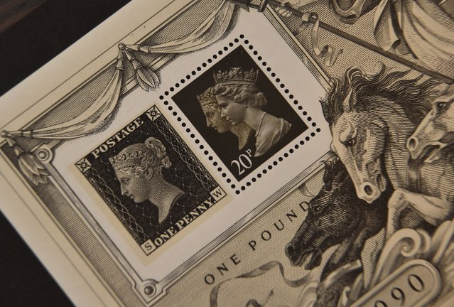 A commemorative stamp (R) from 1990 with depictions of Britain's Queen Elizabeth (R) and Queen Victoria (L) is seen next to an 1840 Penny Black stamp with Queen Victoria on it at Stanley Gibbons in central London, Britain, August 21, 2015. Stanley Gibbons, the world's longest-established rare stamp merchant, is the official philatelist, or provider of stamps, to Queen Elizabeth. (Photo by Toby Melville/Reuters)