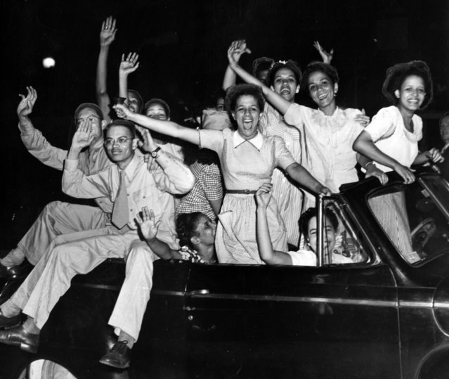 African American youth in a car celebrate victory in Europe at the end of World War 2, Baltimore, Maryland, May 8, 1945. (Photo by Afro American Newspapers/Gado/Getty Images)