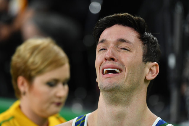 Brazil's Diego Hypolito reacts after competing in the qualifying for the men's pommel horse event of the Artistic Gymnastics at the Olympic Arena during the Rio 2016 Olympic Games in Rio de Janeiro on August 6, 2016. (Photo by Ben Stansall/AFP Photo)